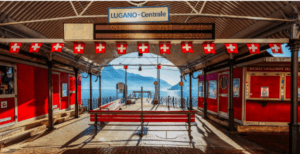 Lugano Centrale station overlooking the glacial Lake Lugano